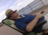 Tom Sayers dozing in a deckchair